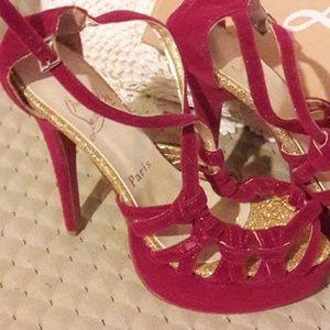 Christian Louboutin fuschia high heels